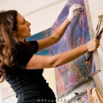 -artist-painting-in-her-studio